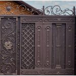 Modern strong decorative gates with wrought iron elements near a residential building.