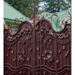wrought iron gate with lanterns painted in brown with gold color